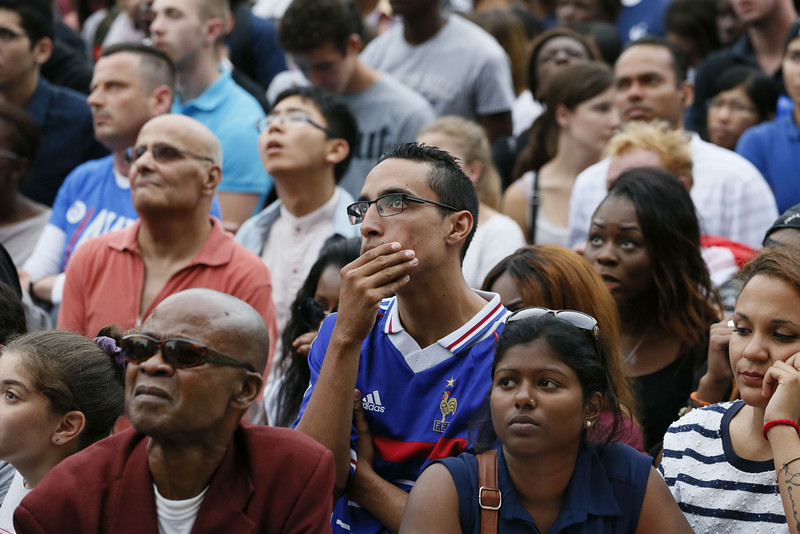 . France fans react as they watch the 2014 FIFA World Cup quarter final football match between France and Germany on a giant screen at the Hotel de Ville (City Hall) in Paris on July 4, 2014. (PATRICK KOVARIK/AFP/Getty Images)