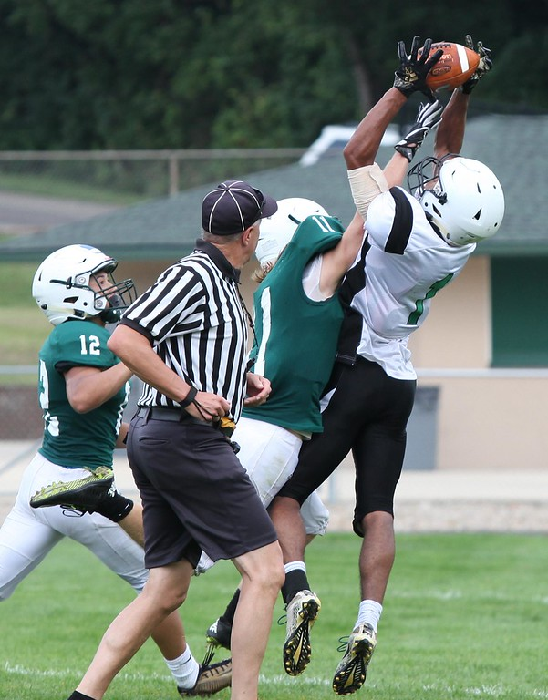 . Randy Meyers - The Morning Journal Columbia\'s Connor Trochley makes a touchdown catch over Jace Drwal of Elyria Catholic during a scrimmage.