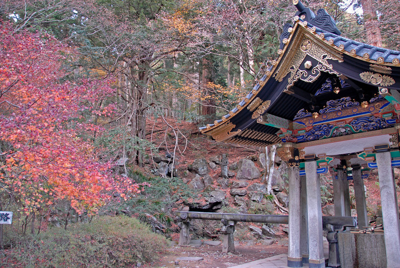 Colorful autumn leaves and a water well at Nikko, Japan