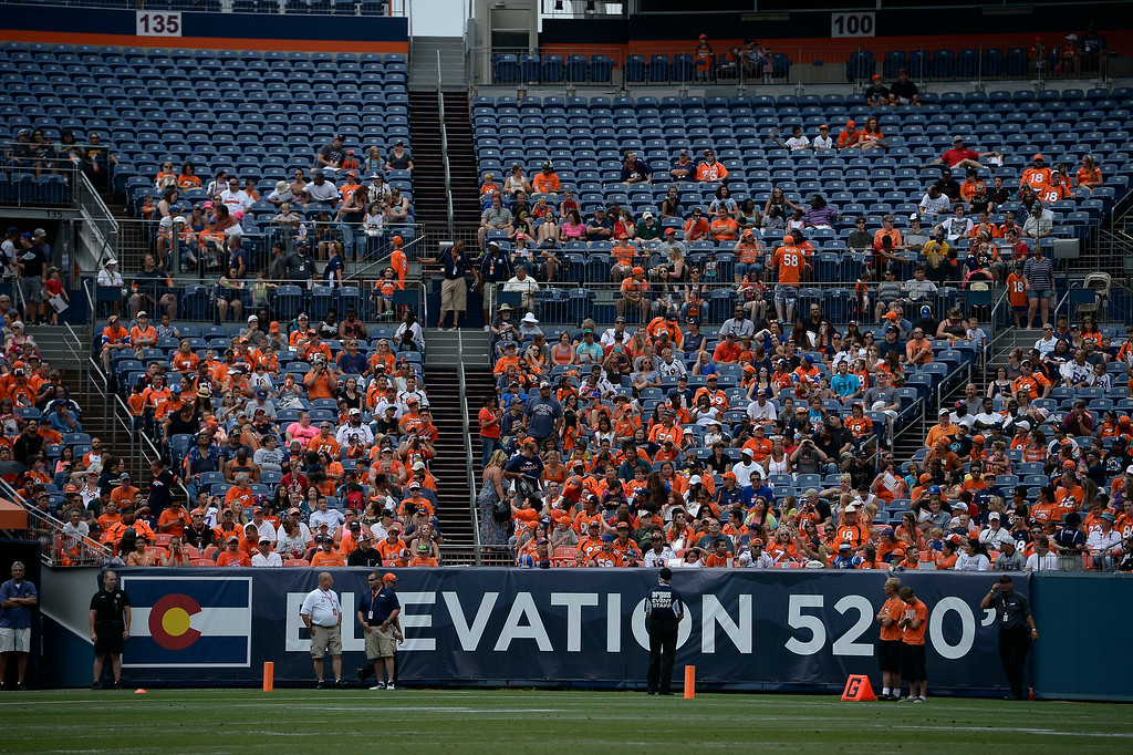 . The Denver Broncos stretch on day four of the Denver Broncos 2014 training camp July 27, 2014 at Sports Authority Field at Mile High. (Photo by John Leyba/The Denver Post)