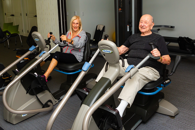 Selma Horowitz (left) and Nat Rosen, 92, exersize on stationary bikes in the fitness room at Tradition at MorseLife on Wednesday, October 31, 2018. Horowitz has lived at Tradition for just over two months and praises the staff, services and accommodations. Rosen, who has lived at Tradition for a little over a year, echoes Horowitz's sentiments. [JOSEPH FORZANO/palmbeachpost.com]