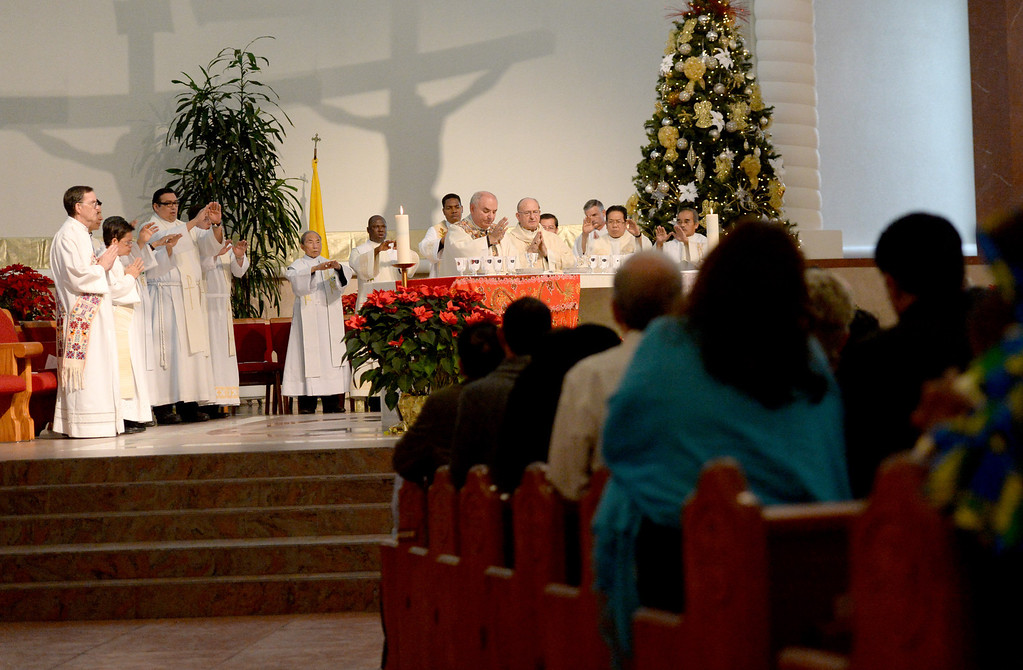 """. Sacred Heart Church in Rancho Cucamonga held the 8th annual Diocesan Migration Mass, lead by Bishop Gerald Barnes at, Sunday, Jan. 12, 2014. \""""We don\'t want anymore family to be divided, we don\'t want anymore children left alone or sent to a country they don\'t know anything about. We want the deportations to stop, and we want also the laws of immigration to change once more because they have changed several times in the last 50 years, so it would be another change for the good.\"""" said Auxiliary Bishop Rutilio del Riego at the conclusion of Sunday\'s mass. (John Valenzuela/Staff Photographer)"""