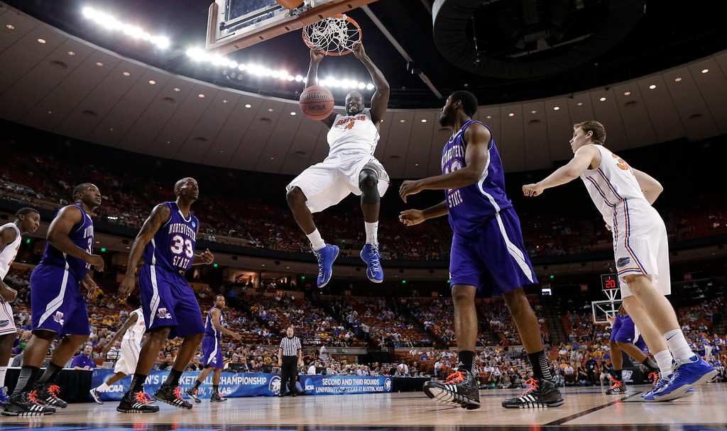 . Florida\'s Patric Young (4) scores between Northwestern State\'s James Hulbin (33) and Marvin Frazier (40) during the first half of a second-round game of the NCAA men\'s college basketball tournament Friday, March 22, 2013, in Austin, Texas. (AP Photo/David J. Phillip)