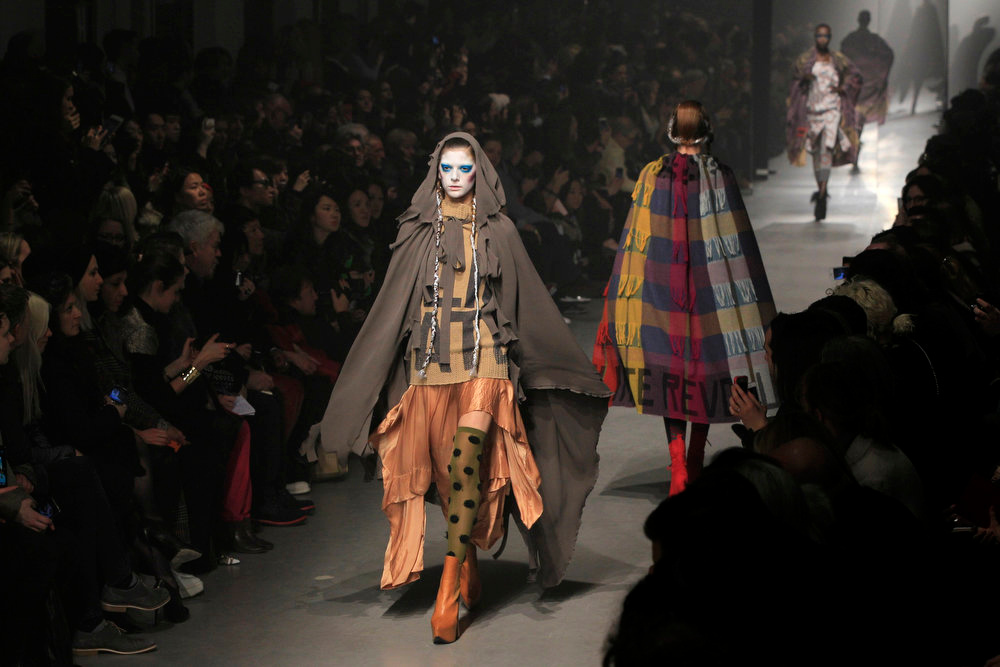 . Models present creations by British designer Vivienne Westwood as part of her Fall-Winter 2013/2014 women\'s ready-to-wear fashion collection during Paris Fashion Week March 2, 2013. REUTERS/Gonzalo Fuentes