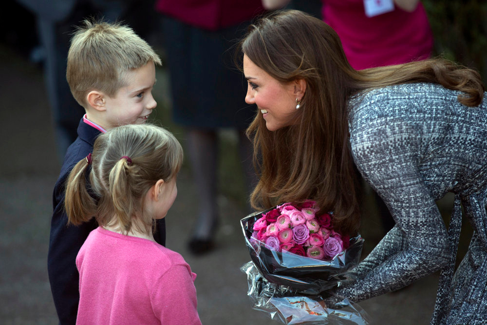 Description of . Britain's Kate, The Duchess of Cambridge receives flowers, as she leaves after a visit to Hope House, in London,  Tuesday, Feb. 19, 2013. As patron of Action on Addiction, the Duchess was visiting Hope House, a safe, secure place for women to recover from substance dependence.   (AP Photo/Matt Dunham)