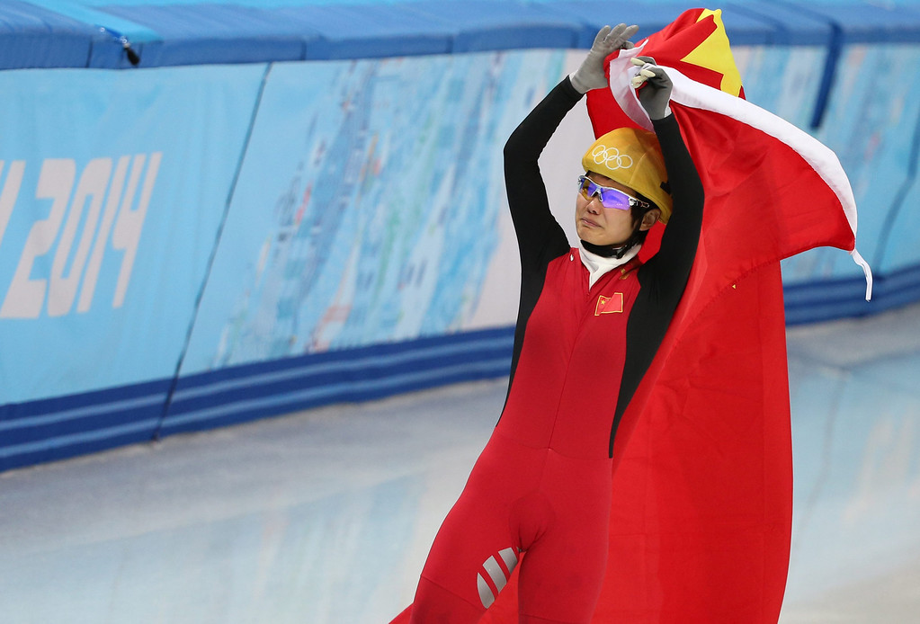. Li Jianrou of China celebrates after she won gold in the women\'s 500m of the Short Track events in the Iceberg Skating Palace at the Sochi 2014 Olympic Games, Sochi, Russia, 13 February 2014.  EPA/HOW HWEE YOUNG