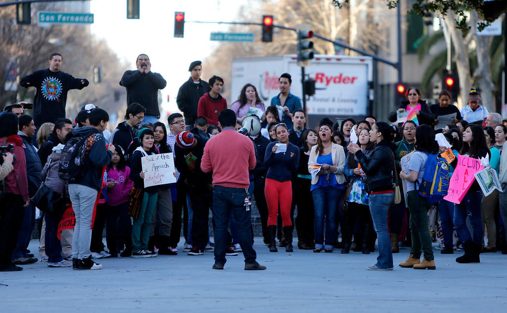 ". Protestors chant at Plaza De Cesar Chavez during an ""Immigration Reform Now\"" rally in San Jose, Calif., on Thursday, Feb. 21, 2013.  They were protesting comprehensive immigration reform.  They began at Dr. Martlin Luther King, Jr. Library and ended at the Robert F. Peckham Federal Building.  (Nhat V. Meyer/Staff)"