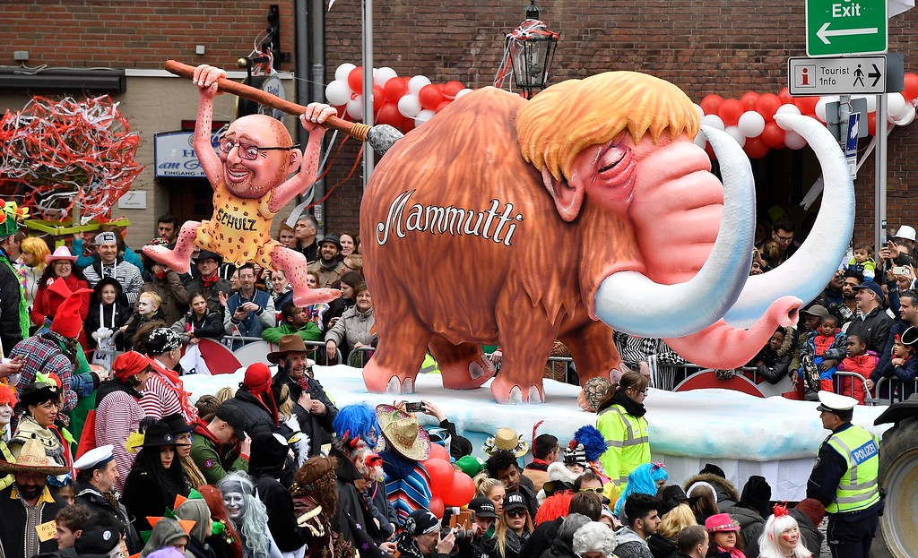 . A carnival float depicting German chancellor Angela Merkel as mammoth and chancellor candidate Martin Schulz of the the Social Democrats participates at the traditional carnival parade in Duesseldorf, Germany, on Monday, Feb. 27, 2017. The foolish street spectacles in the carnival centers of Duesseldorf, Mainz and Cologne, watched by hundreds of thousands of people, are the highlights in Germany\'s carnival season on Shrove Monday. (AP Photo/Martin Meissner)