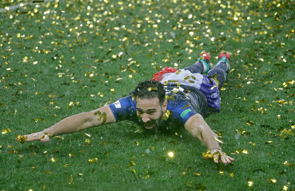 . France\'s Adil Rami celebrates after the final match between France and Croatia at the 2018 soccer World Cup in the Luzhniki Stadium in Moscow, Russia, Sunday, July 15, 2018. France won the final 4-2. (AP Photo/Matthias Schrader)