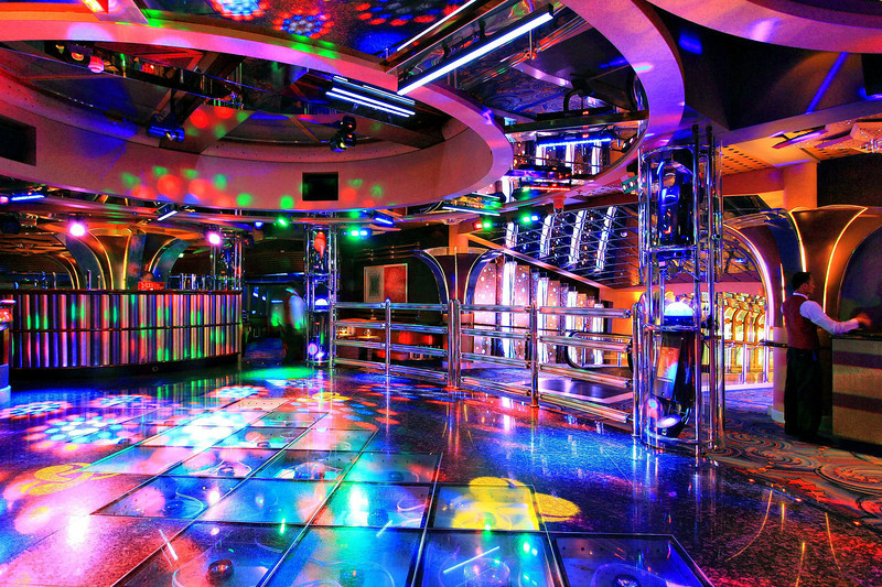 This is Skywalker's, a dance club high up in the rear wing of the cruise ship on level 18. I took this photo just as the club opened because I wanted a clean shot of the floor with all the lights on it. Other photos of the ship are at the end of this gallery.