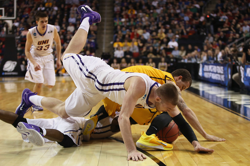 . Seth Tuttle #10 of the Northern Iowa Panthers and Josh Adams #14 of the Wyoming Cowboys battle for a loose ball during the second round of the 2015 Men\'s NCAA Basketball Tournament at KeyArena on March 20, 2015 in Seattle, Washington.  (Photo by Otto Greule Jr/Getty Images)