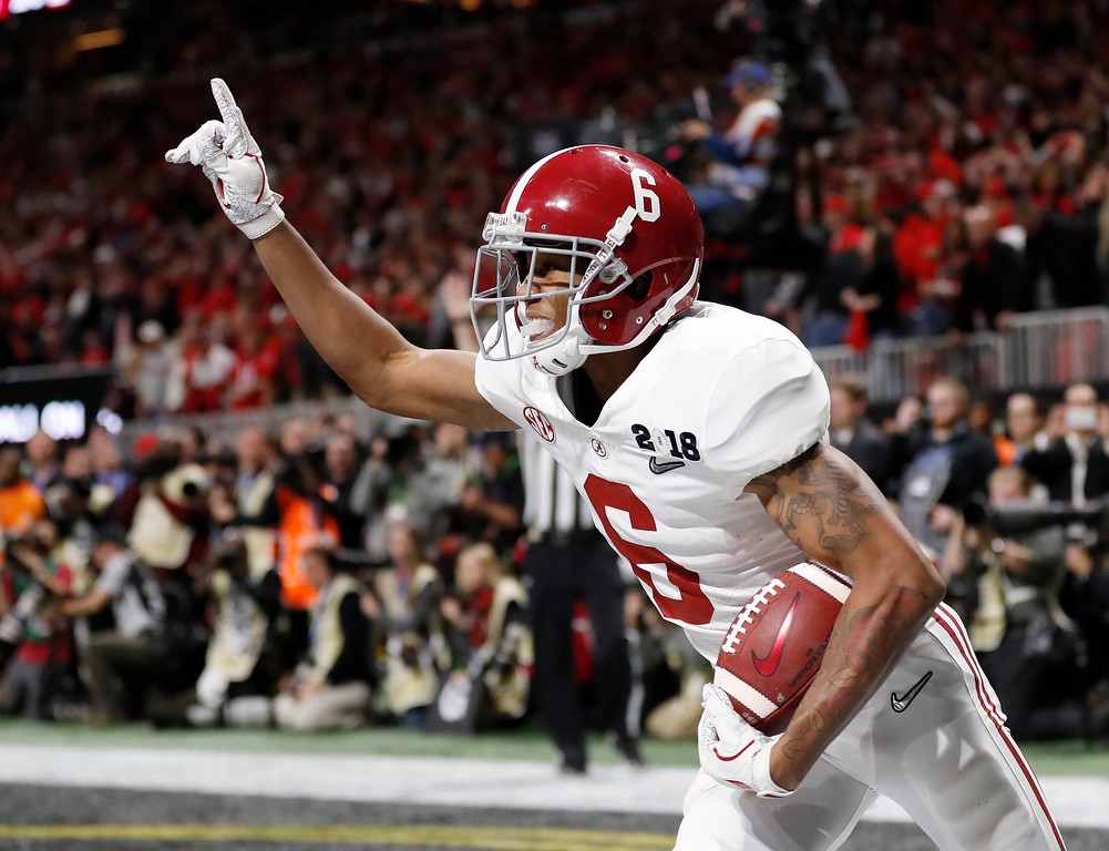 . Alabama wide receiver DeVonta Smith (6) celebrates his touchdown during overtime of the NCAA college football playoff championship game against Georgia, Monday, Jan. 8, 2018, in Atlanta. Alabama won 26-23 in overtime. (AP Photo/David Goldman)