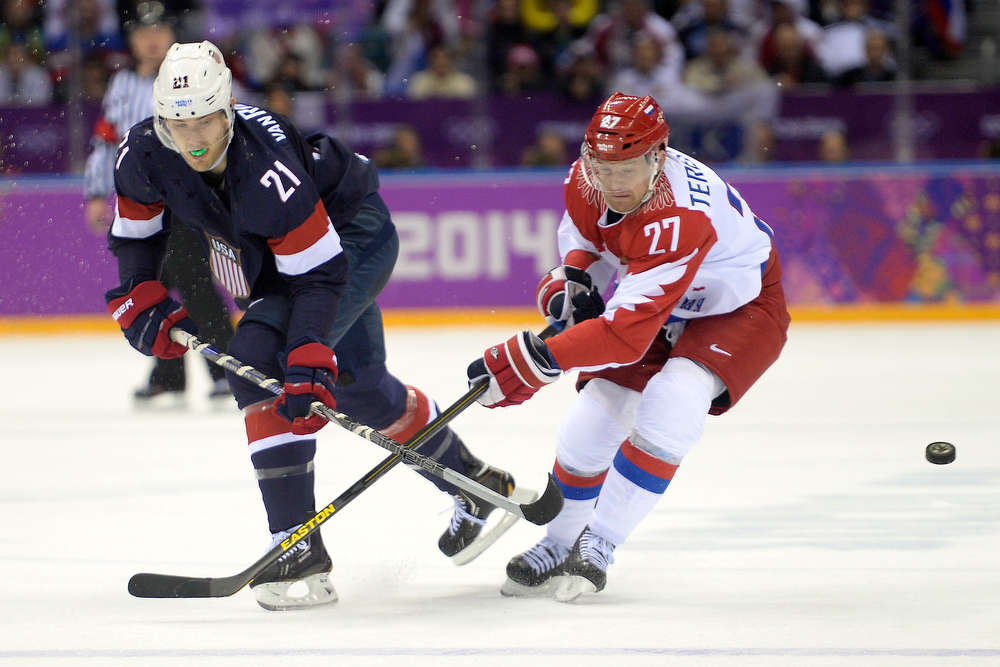 . Alexei Tereshenko (27) of the Russia defends James van Riemsdyk (21) of the U.S.A.during  the third period of the U.S.A.\'s win at Bolshoy arena. Sochi 2014 Winter Olympics on Saturday, February 15, 2014. (Photo by AAron Ontiveroz/The Denver Post)