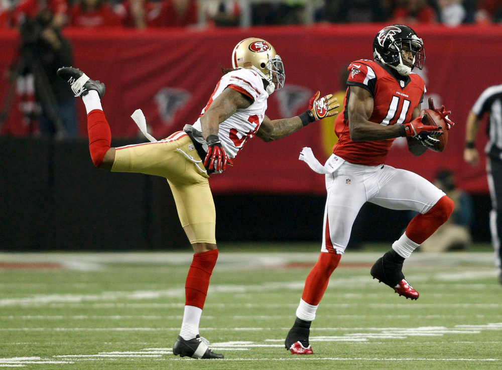 . Atlanta Falcons wide receiver Julio Jones catches a pass as San Francsico 49ers\' Dashon Goldson tries to defend during first quarter in the NFL NFC Championship football game in Atlanta, Georgia January 20, 2013.  REUTERS/Tami Chappell