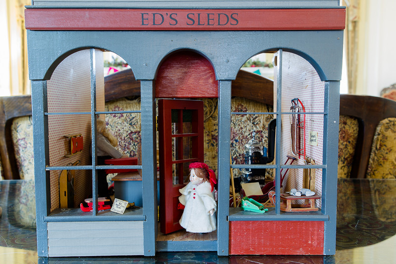 . Could someone have just bought a sled at Ed\'s? A miniature sled store is one of the contributions of the Denver Museum of Miniatures, Dolls and Toys to the decorations at the Governor\'s mansion. Photo by Mark Broste