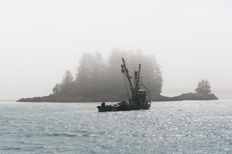 Fishing boat and foggy island