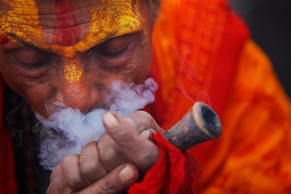 . A Hindu holy man smokes marijuana in the courtyard of the Pashupatinath Temple in Katmandu, Nepal, Wednesday, Feb. 26, 2014.  (AP Photo/Niranjan Shrestha)