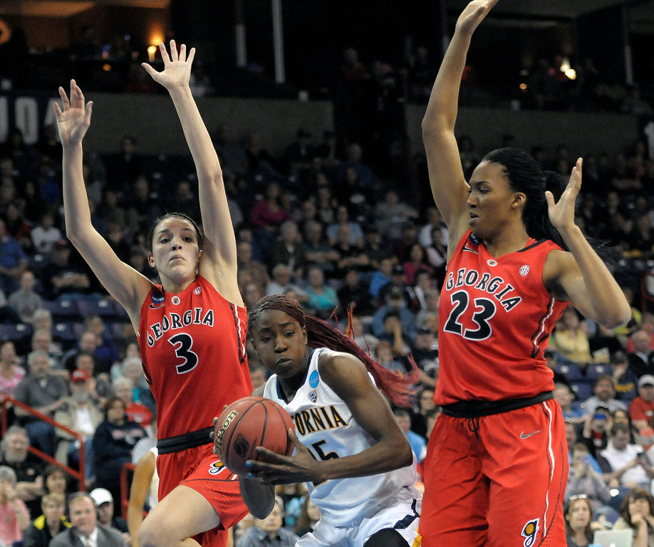 . California\'s Gennifer Brandon (25) is pressured by Georgia\'s Anne Marie Armstrong (3) and Tamika Willis (23) during the first half in a regional final in the NCAA women\'s college basketball tournament, Monday, April 1, 2013, in Spokane, Wash. (AP Photo/Jed Conklin)
