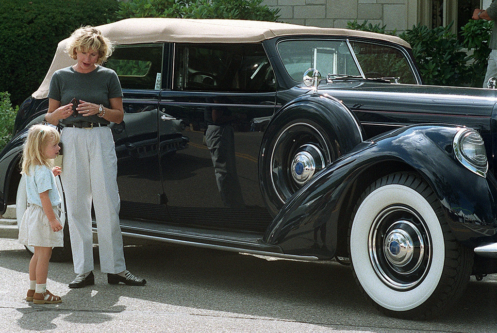 . As her mom Maureen stands by, Ashley Charlebois,3,  probably doesnt realized that she is examining one of only 12 Lincoln Model K\'s ever made. The navy 1937 auto was one of dozens of vintage Ford Motor Company products that ringed Shain Park Friday night as part of a private Revvin\' with Ford event that kicks off Dream Cruise activites this weekend.