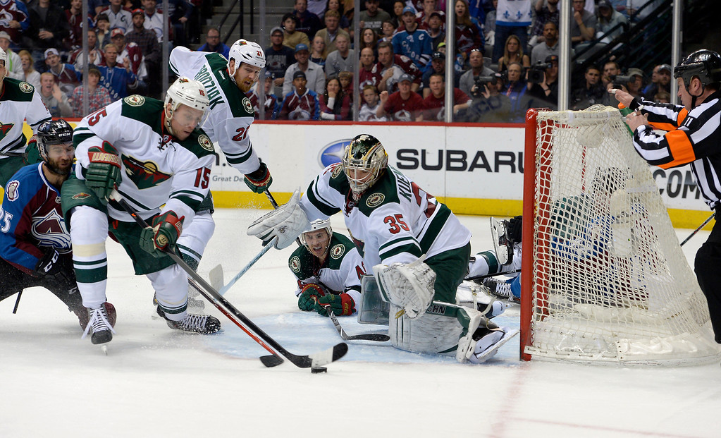. DENVER, CO - APRIL 26: Minnesota Wild left wing Dany Heatley (15) keeps the puck out of the crease during the third period of action. The Colorado Avalanche hosted the Minnesota Wild in the fifth round of the Stanley Cup Playoffs at the Pepsi Center in Denver, Colorado on Saturday, April 26, 2014. (Photo by John Leyba/The Denver Post)