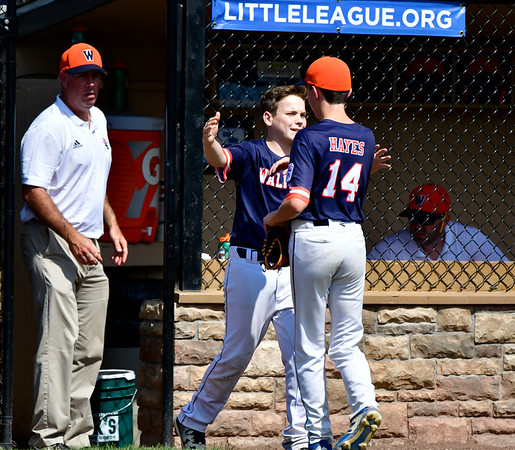 8/4/2019 Mike Orazzi | Staff Massachusetts's Richie Hayes (14) and Peter Bachiochi (3) after Hayes reaches his pitch count during their opening round game of the New England Regional Little League Baseball Tournament in Bristol on Sunday.