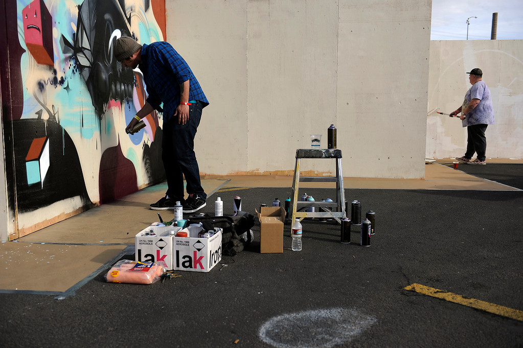 . DENVER, CO - APRIL 4: Mike Gallegos, of Denver, tags a wall in the art area during the Snowball Music Festival at Sports Authority Field at Mile High Stadium on April 4, 2014 in Denver, Colorado. The Snowball Music Festival is celebrating its first year in Denver after spending the previous three years as a mountain based festival. (Photo by Seth McConnell/The Denver Post)