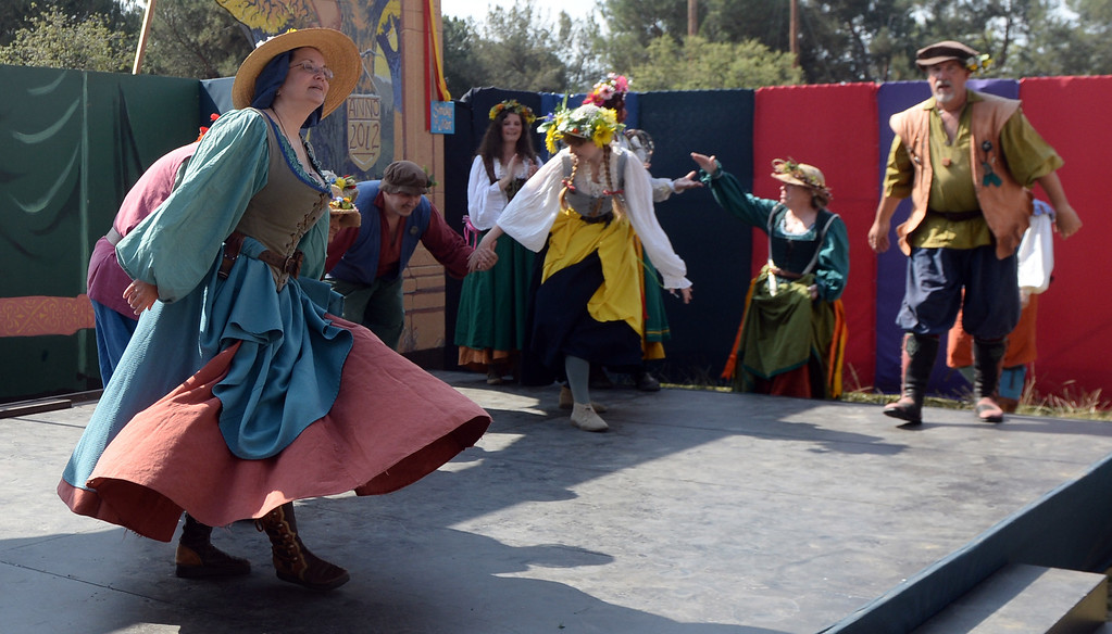 . Performers dance on opening day of the Renaissance Pleasure Faire at Santa Fe Dam Recreation Area in Irwindale, Calif., on Saturday, April 5, 2014. 