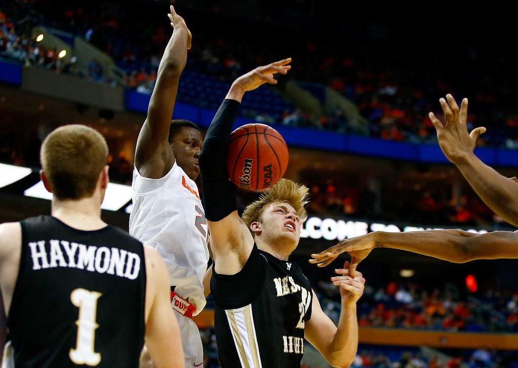. BUFFALO, NY - MARCH 20: Connar Tava #2 of the Western Michigan Broncos and Tyler Roberson #21 of the Syracuse Orange fight for a rebound during the second round of the 2014 NCAA Men\'s Basketball Tournament at the First Niagara Center on March 20, 2014 in Buffalo, New York.  (Photo by Jared Wickerham/Getty Images)