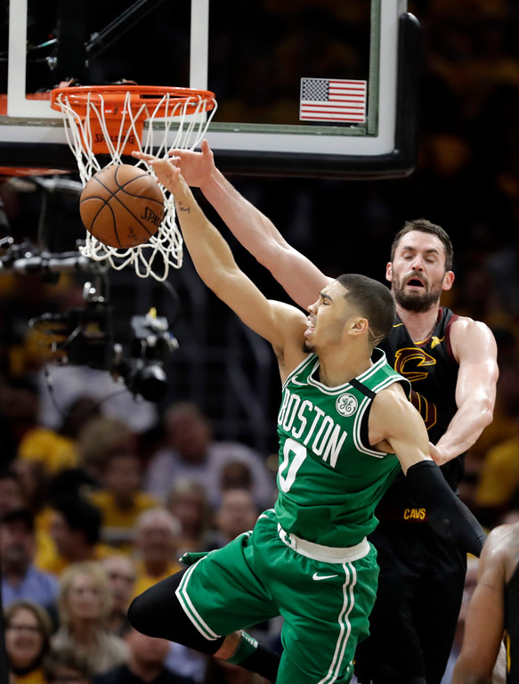 . Cleveland Cavaliers\' Kevin Love, right, and Boston Celtics\' Jayson Tatum, left, go for a rebound in the first half of Game 3 of the NBA basketball Eastern Conference finals, Saturday, May 19, 2018, in Cleveland. (AP Photo/Tony Dejak)