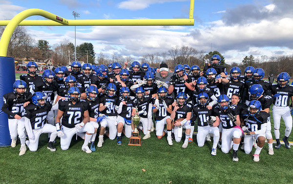 11/28/19 Wesley Bunnell | StaffrrPlainville football defeated Farmington on Thanksgiving morning at Plainville High School. Plainville poses with the Olde Canal Cup following the victory.