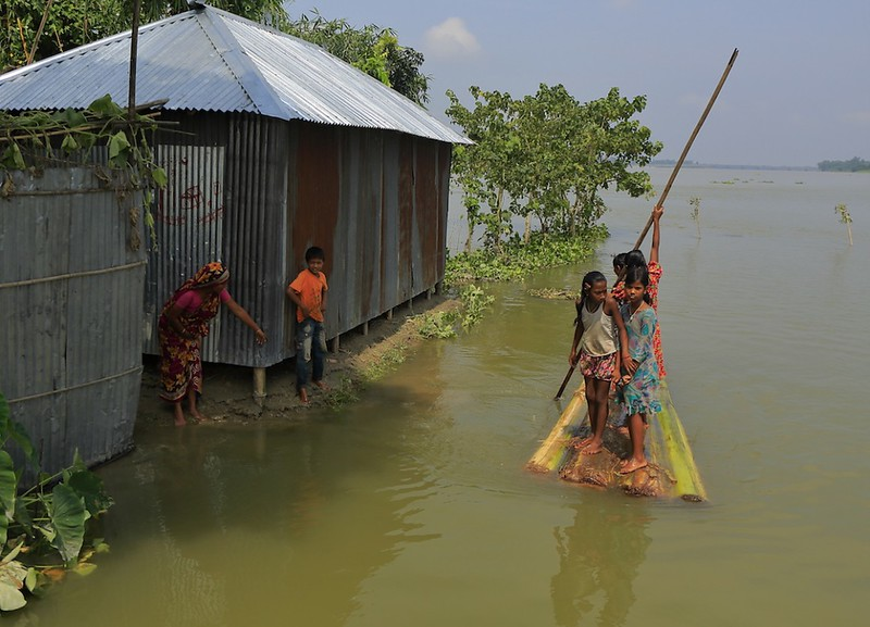 UN076394 banner shot of girls in floodwaters in Bangladesh 1200 by 900.jpeg