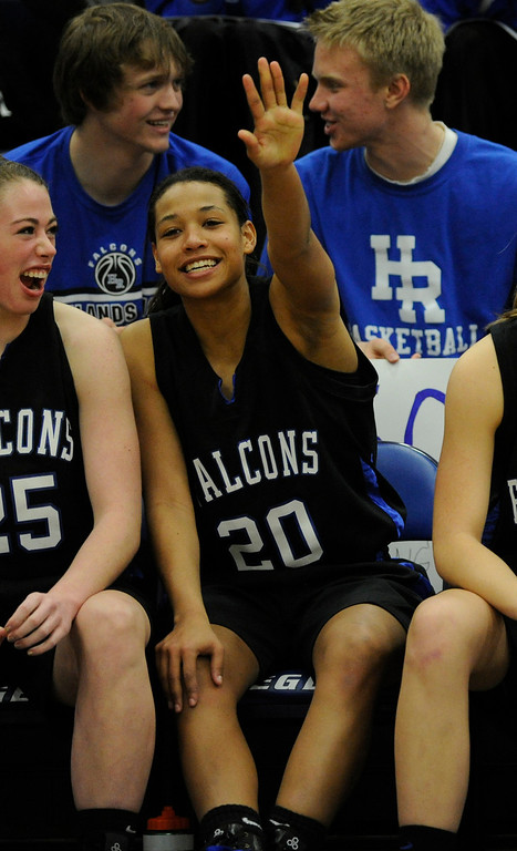 . PARKER, CO. - FEBRUARY 15: Falcons starter Ciera Morgan cheered on the team from the bench in the fourth quarter. The Highlands Ranch High School girls\'s basketball team defeated Legend 76-31 Friday night, February 15, 2013. Falcon\'s coach Caryn Jarocki earned her 500th career win. (Photo By Karl Gehring/The Denver Post)