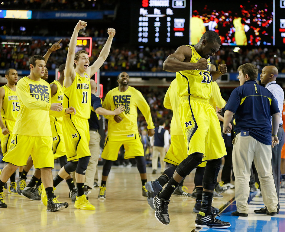 . Michigan players react after the second half of the NCAA Final Four tournament college basketball semifinal game against Syracuse, Saturday, April 6, 2013, in Atlanta. Michigan won 61-56. (AP Photo/Charlie Neibergall)