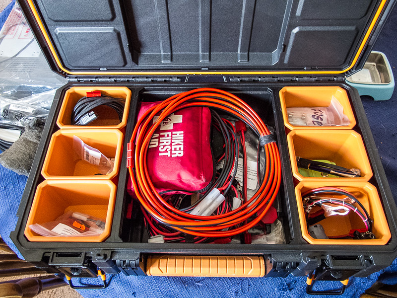 Upper supplies box containing first aid kit, clipboard, various adapter harnesses. fuses and other accessories. (Pardon the empty cat food bowl in the background.)