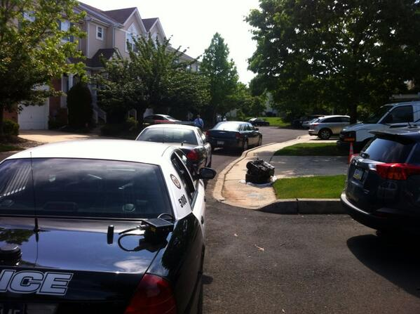 Description of . Police converge on Harvard Drive in Montgomery Township after a shooting Monday, June 2, 2014. (Photo by Geoff Patton/The Reporter)