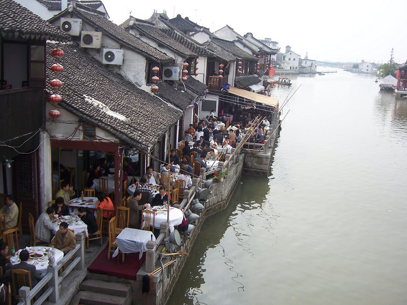 Zhu Jia Jiao, nr Shanghai, is a classic water village, over 400 years old with a signature five-arch bridge spanning the Cao Gang River. Zhu Jia Jiao was an important town for local trade, shipping goods in and out of its man made canals to the river.
