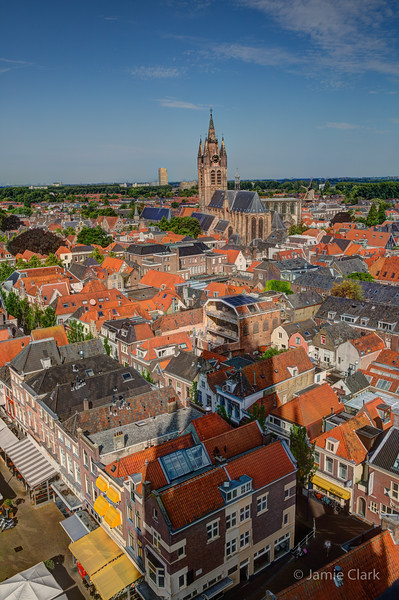 Still looking at the horizon (I swear the moon looks close enough to touch) Looking towards Old Church from pretty darn high up. Delft, Netherlands