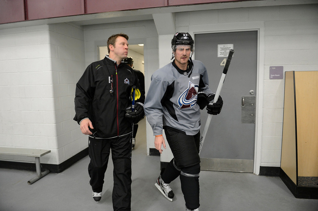 . Colorado Avalanche coach Joe Sacco walks out to the ice with Milan Hejduk (23) during training camp Tuesday, January 15, 2013 at Family Sports Center. John Leyba, The Denver Post