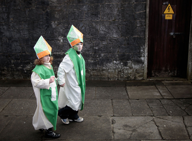. Children make their way to the St. Patrick\'s Day parade during the St. Patrick\'s Day celebrations in Limerick, Ireland, Sunday, March 17, 2013.  (AP Photo/Peter Morrison)