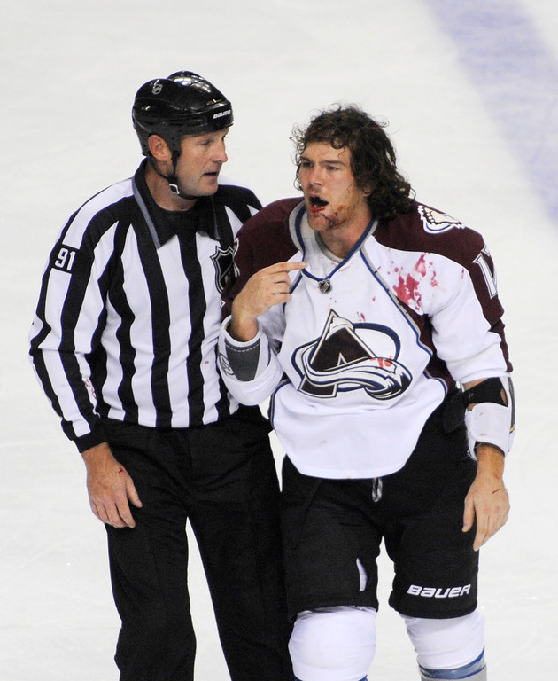 . NHL linesman Don Henderson (91) skates Colorado Avalanche right winger Steve Downie to the penalty box after a fight with Buffalo Sabres\' Mike Weber during the third period of an NHL hockey game in Buffalo, N.Y., Saturday, Oct. 19, 2013. Colorado won 4-2.  (AP Photo/Gary Wiepert)