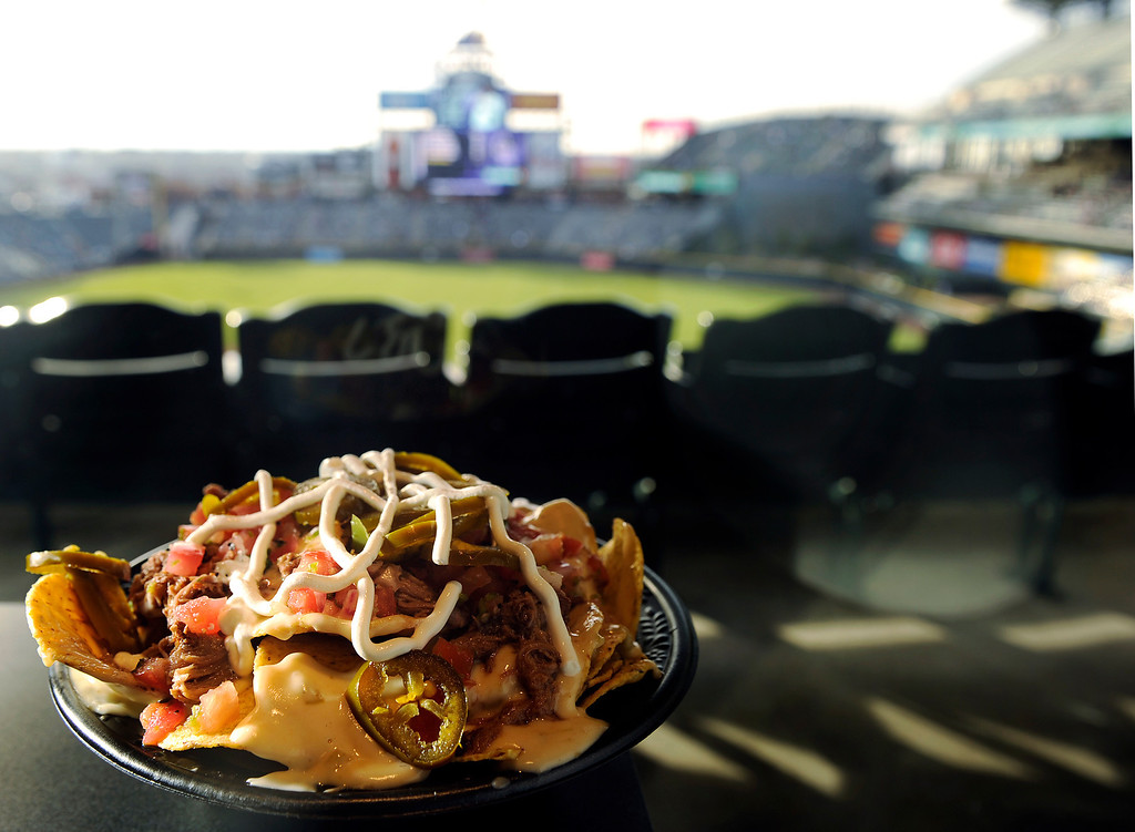 . The Colorado Queso Nachos with: Fresh corn chips with spicy chorizo sausage covered with Monterrey jack and green chili cheese sauce topped with pico de gallo and sour cream  in the Wells Fargo Club level seats at the Denver  baseball park on May 3, 2013 before the Rockies game. (Photo By Cyrus McCrimmon/The Denver Post)