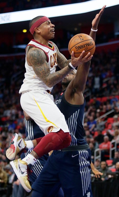 . Cleveland Cavaliers guard Isaiah Thomas, left, goes to the basket against Detroit Pistons forward Anthony Tolliver during the second half of an NBA basketball game Tuesday, Jan. 30, 2018, in Detroit. The Pistons defeated the Cavaliers 125-114. (AP Photo/Duane Burleson)
