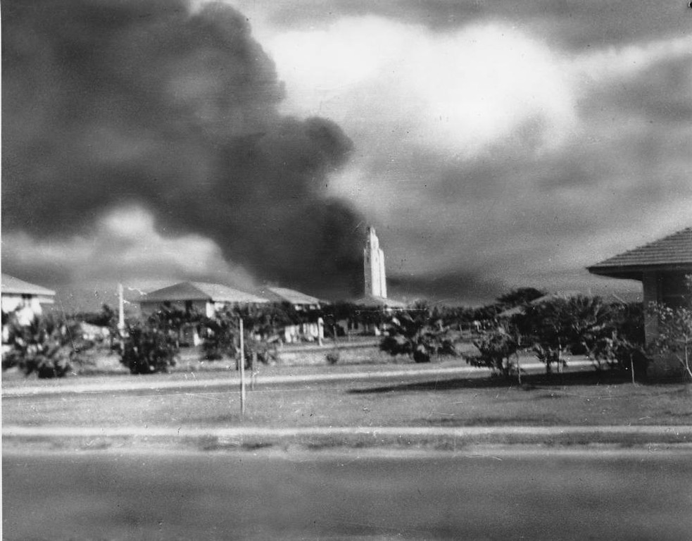 ". A column of black smoke rises from the U.S. Navy base in Pearl Harbor, Oahu, Hawaii at 7:55 a.m., Sun., Dec. 7, 1941 as Japan declared war against the United States.  Bombs exploding over ""Battleship Row,\"" awakened Mrs. Mary Naiden of New York City, who was serving as a hostess at the Army\'s Hickam Field.  She thought a U.S. plane had crashed into a gasoline or oil depot and took this photo without leaving her room.   (AP Photo/Mary Naiden)"