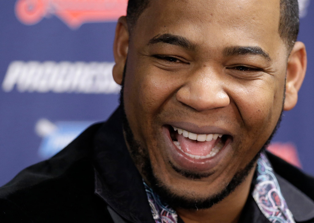 . Cleveland Indians\' Edwin Encarnacion smiles during a news conference, Thursday, Jan. 5, 2017, in Cleveland. One win from a World Series baseball title last season, the Indians finalized a $65 million, three-year contract with free agent slugger Encarnacion. (AP Photo/Tony Dejak)