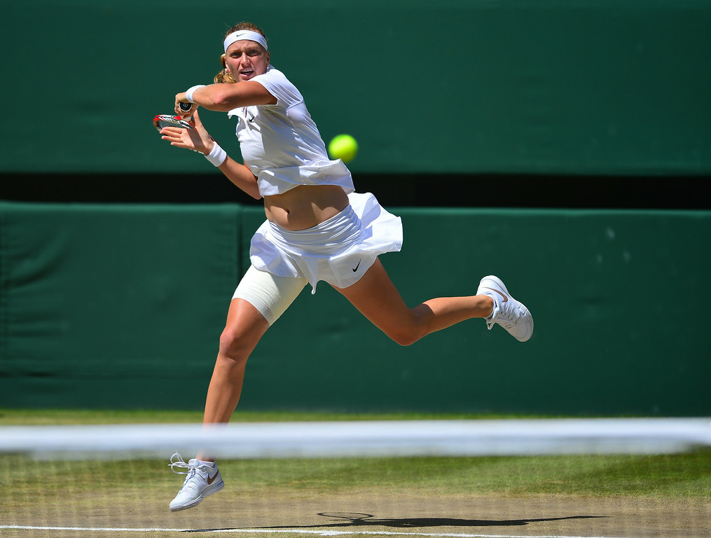 . Czech Republic\'s Petra Kvitova returns to Czech Republic\'s Lucie Safarova during their women\'s singles semi-final match on day ten of the 2014 Wimbledon Championships at The All England Tennis Club in Wimbledon, southwest London, on July 3, 2014. Kvitova won 7-6, 7-1.  CARL COURT/AFP/Getty Images
