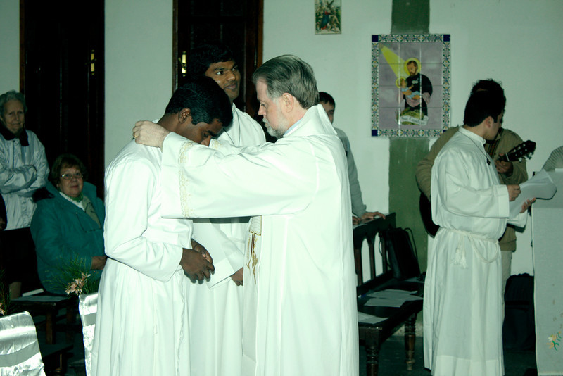 Fr. Sebastian, SCJ (Brazil) presents each with the Final Vow Cross, and offers congratulations.