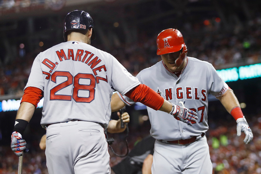 . Los Angeles Angels of Anaheim outfielder Mike Trout (27) is welcomed at the dugout by Boston Red Sox\'s J.D. Martinez (28) after his solo home run during the third inning of the Major League Baseball All-Star Game, Tuesday, July 17, 2018, in Washington. (AP Photo/Patrick Semansky)