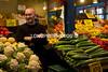 Proprietor selling his vegetables.