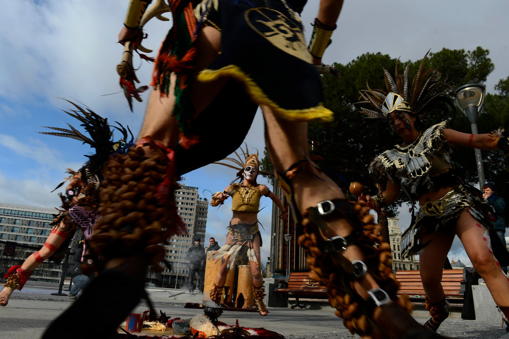 . Dancers dressed in costumes and head-dresses perform during a ceremony marking the end of the Mayan age, on December 21, 2012 in Madrid. Ceremonies are being held to celebrate the end of the Mayan cycle known as Bak\'tun 13 and the start of the new Maya Era on December 21.  PIERRE-PHILIPPE MARCOU/AFP/Getty Images