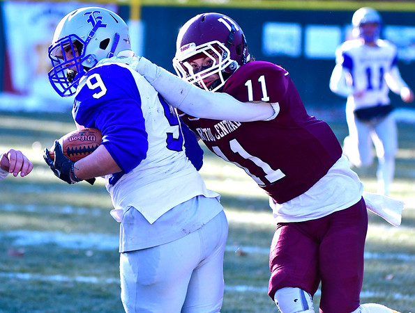 11/23/2018 Mike Orazzi   Staff Bristol Eastern's Matt DAmato (9) and Central's Jose Navedo (11) during the Battle for the Bell at Muzzy Field Friday. Central won 24-19.